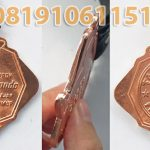 medali timah