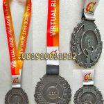 medali timah ride hut